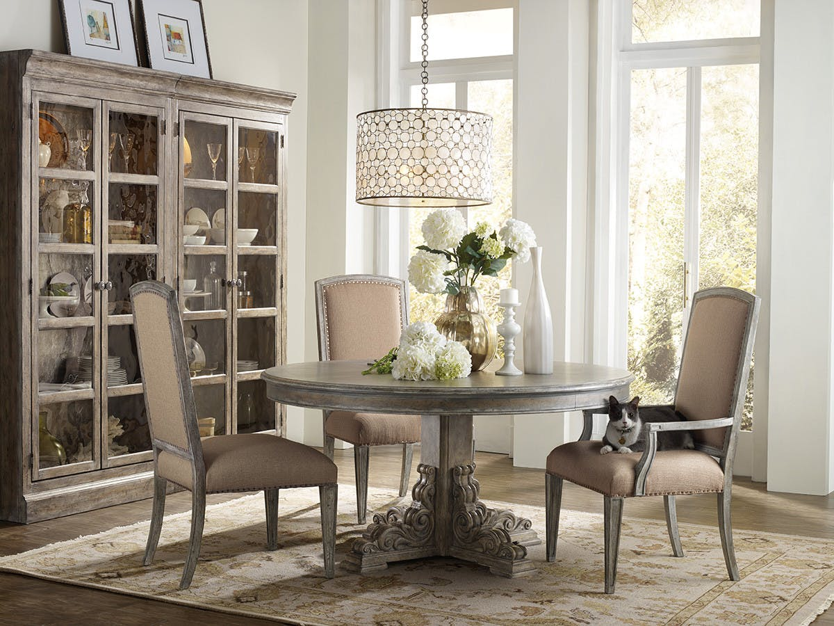 Of true vintage dining a softly carved base compliments a 60 inch round dining table finish off your room with soft upholstered dining chairs