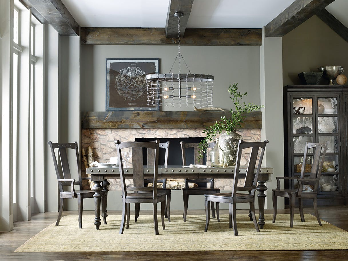Vintage West Dining Pieces Include A Rectangular Table That Extends To 108  Inches, Splatback Chairs And Bunching Curios.