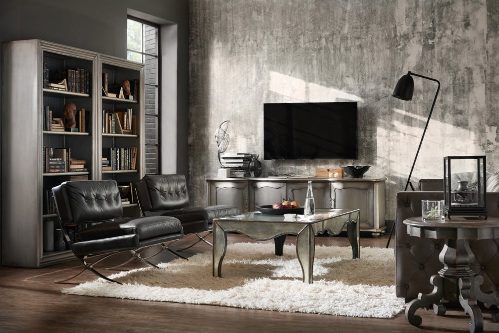 Wrapped In Aluminum, The Entertainment Console And Bookcases In This  Industrial Luxe Living Room Really Pop. They Are Accompanied By The  Eglomise Cocktail ...